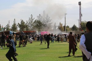 People react after twin bomb blasts targeting the Farmers Day ceremony attended by the Governor of Helmand province, in Helmand on Saturday. According to reports at least three people were killed and more than 30 others were wounded