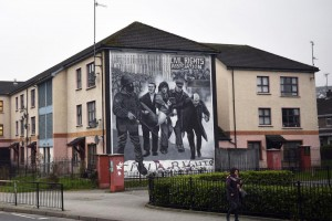 The Bloody Sunday mural depicts Priest Edward Daly waving a bloodstained handkerchief as one of the victims of the attack, Jackie Duddy, is carried to safety, in Derry, Northern Ireland. Prosecutors will charge one former U.K. soldier for the 1972 massacre that killed 14 people. Photo by Neil Hall