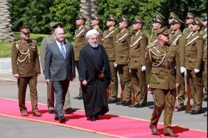 Iraqi President Barham Salih (L) and Iranian President Hassan Rouhani review honor guards Monday at the presidential palace in Baghdad, Iraq. Photo by Ahmed Jalil/