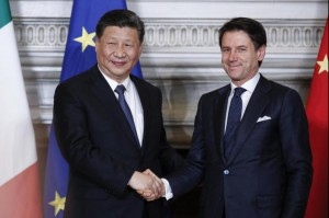 Italian premier Giuseppe Conte (R) shakes hands with Chinese President Xi Jinping during their meeting at the Villa Madama in Rome Saturday where Italy signed a memorandum of understanding to make Italy the first Group of Seven leading democracies to join China's ambitious Belt and Road infrastructure project. Photo by Giuseppe Lami/
