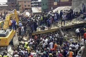 Rescuers work at the scene of a building collapse in Ita Faji, Lagos, Nigeria, on Wednesday. Photo by Israel Ophori/