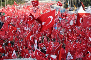 Citizens hold Turkish flags during a celebration in Istanbul, Turkey. New figures Monday showed the country has entered its first recession in nine years. File Photo by Tolga Bozoglu/