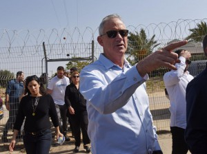 Benny Gantz, leader of the new Israeli Blue and White Party, points to Gaza in the distance, after crossing inside the security fence in Kfar Aza on the Israeli-Gaza border in southern Israel. Photo by Debbie Hill/
