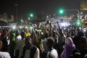 Sudanese people gather to celebrate in the streets of Khartoum, on Friday night after Awad Ibn Auf, Sudanese defense minister and head of Sudan's military council, stepped down a day after leading a military coup that ousted long-time leader Omar al-Bashir amid a wave of protests. Awad Ibn Auf named as his successor Lt.