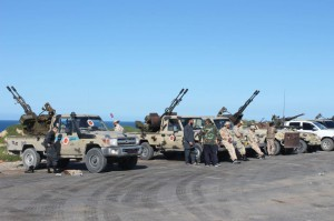 Vehicles and militants, reportedly from Misrata, gather to join Tripoli forces, in Tripoli, Libya, on April 6. Khalifa Haftar, the commander of the Libyan National Army, ordered Libyan forces loyal to him to take the capital Tripoli, held by a U.N.