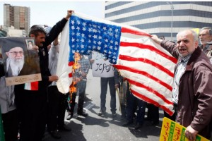 Demonstrators burn a U.S. flag in Tehran, Iran, Friday amid national rallies supporting Iran's rejection of U.S. sanctions.