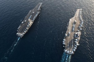 An aerial view of the Nimitz-class aircraft carriers USS John C. Stennis and USS Abraham Lincoln, which are expected to meet in the Persian Gulf in response to Iranian threats.