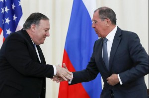 U.S. Secretary of State Mike Pompeo (L) and Russian foreign minister Sergei Lavrov shake hands Tuesday in Sochi, Russia.