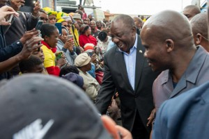 South African President Cyril Ramaphosa greets supporters before he votes in the country's national elections. The ruling ANC party retained power with 57 percent of the vote