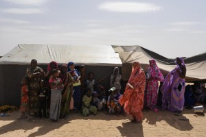 Displaced Malian citizens are seen in the village of Koygouma, Mali, on May 6 as a United Nations delegation visits.
