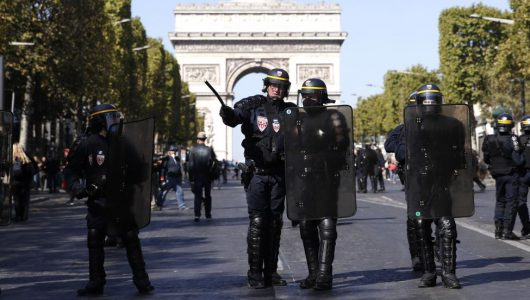 Paris police fire tear gas to stop yellow vest protesters