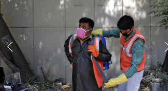I do feel afraid': Indian workers disinfect coronavirus hotspots