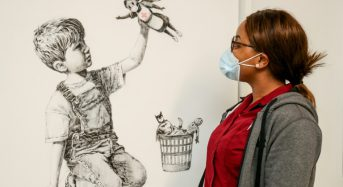 Banksy tribute to UK health service displayed in hospital